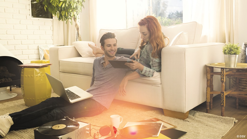 Couple using digital tablet listening to vinyl records